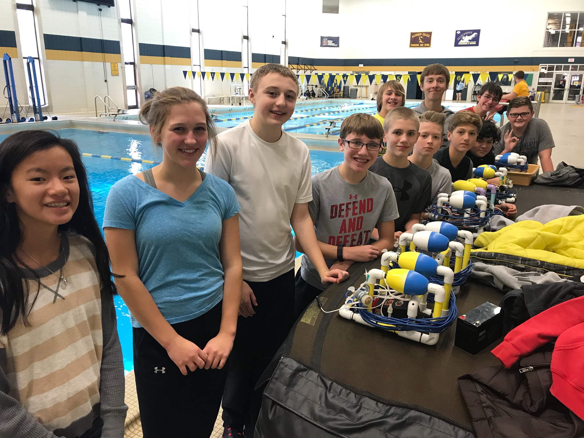 robotics lab students and robot they built