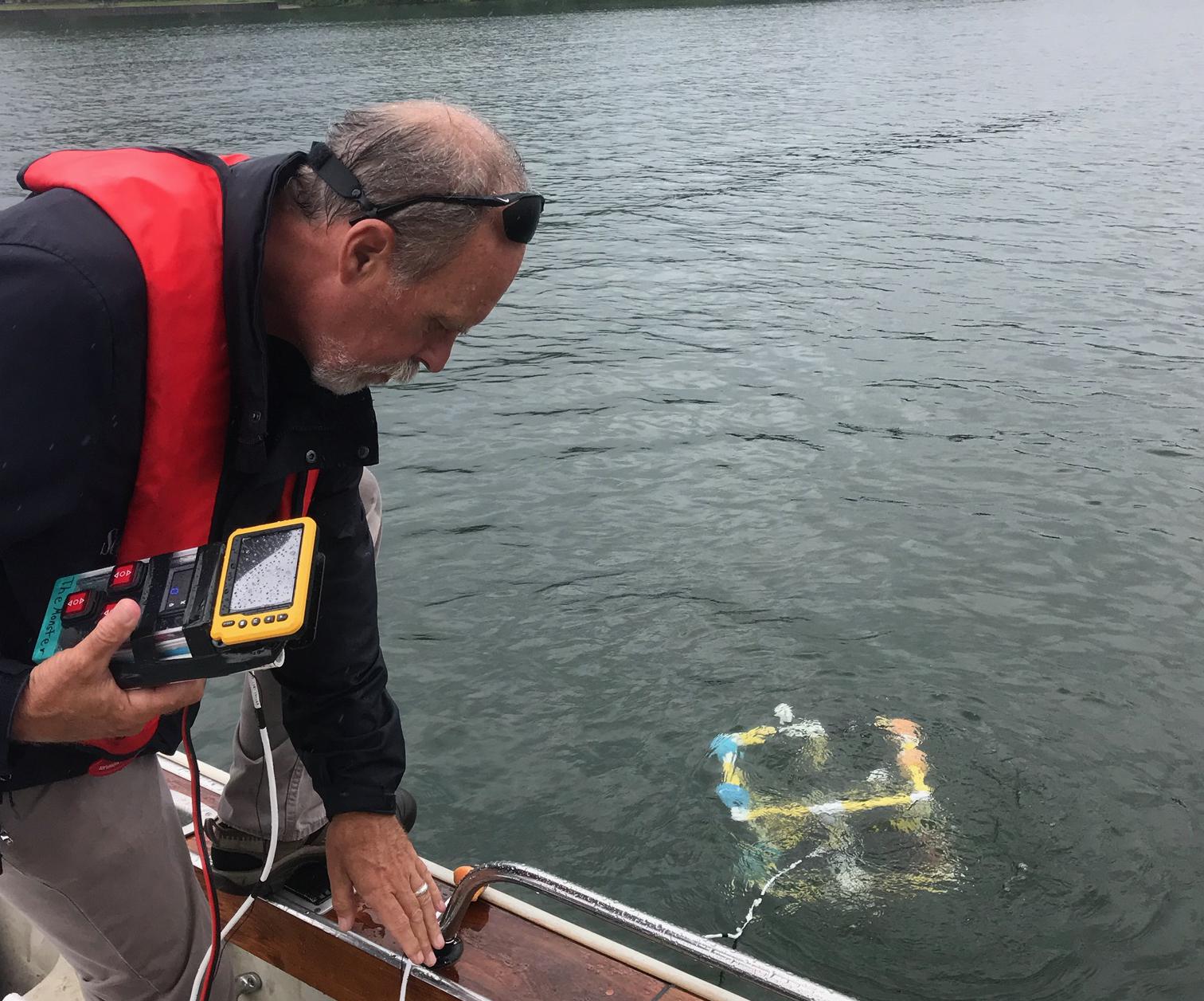 David Boughton participating in survey of underwater fish habitat structures