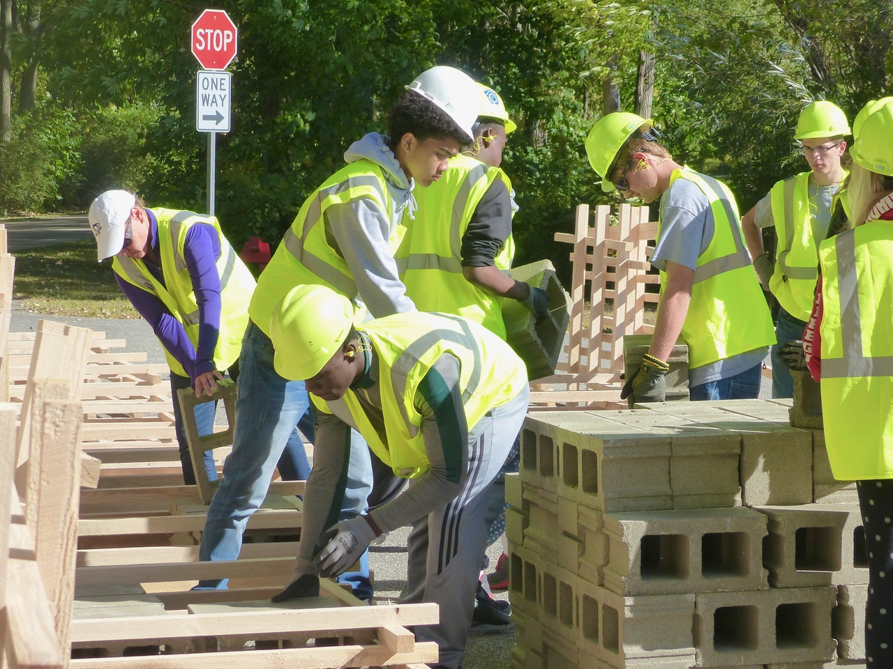Students and volunteers building fish habitat structures
