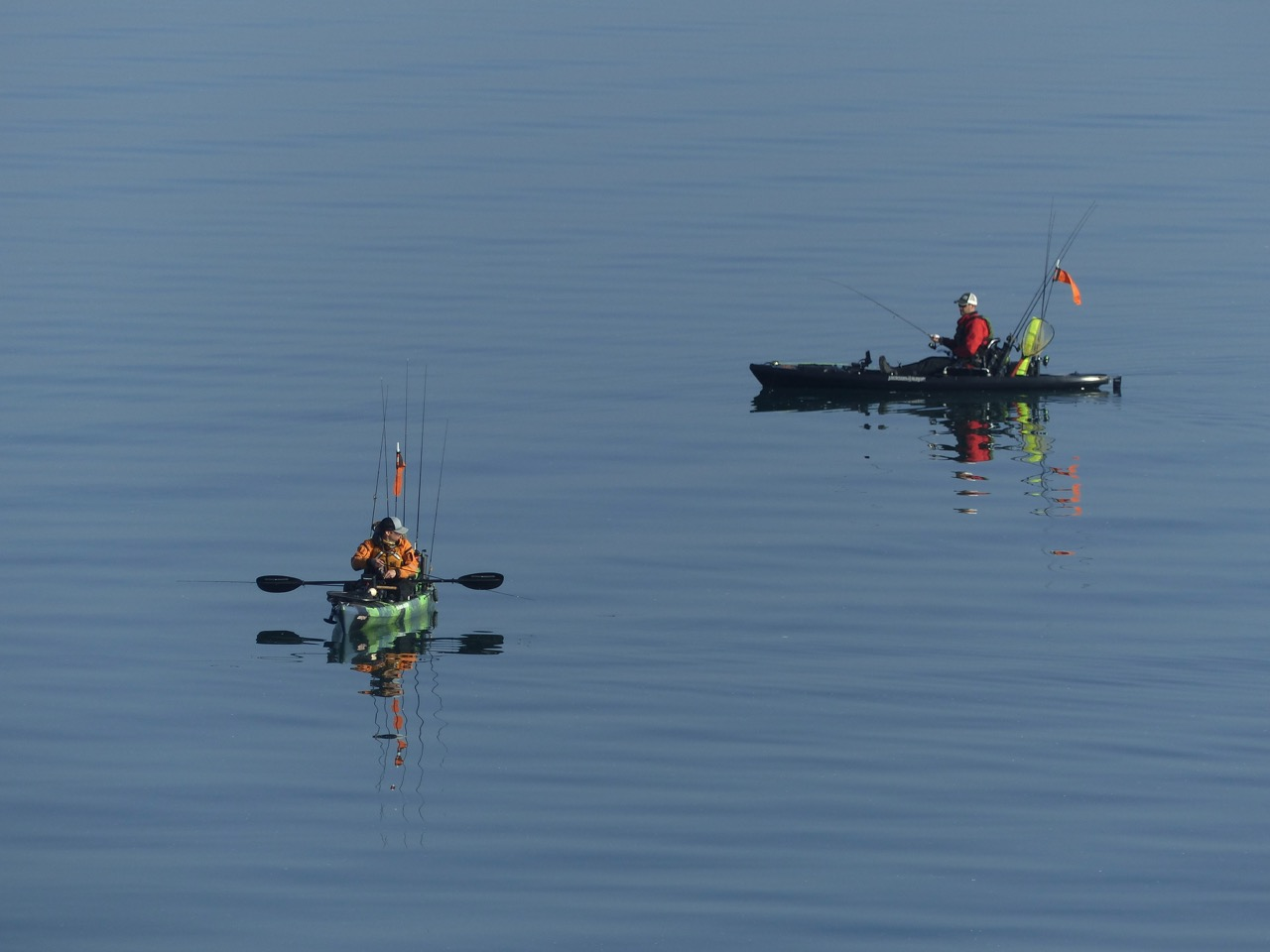 anglers relaxing in kayaks on Lake Erie