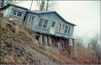 house falling due to bluff recession
