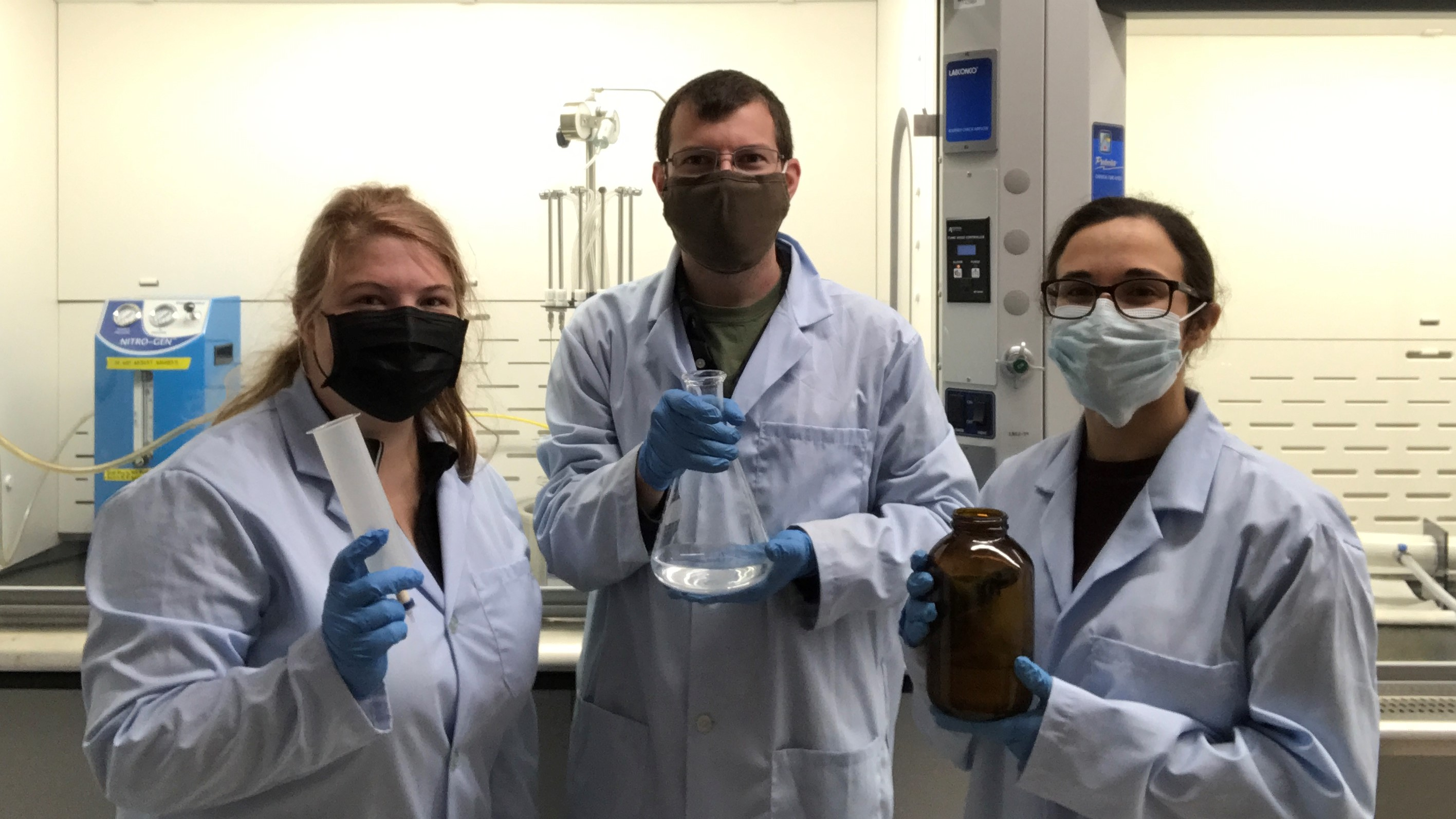three Penn State researchers in laboratory