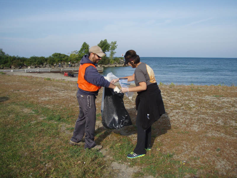collecting trash at coastal cleanup