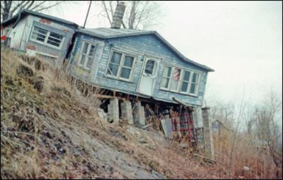 house falling off a cliff due to bluff recession