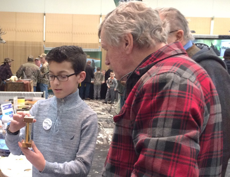 student shares information with visitor